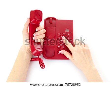 Dialing on the red phone - stock photo