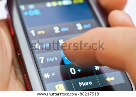 dialing on touch screen smartphone - stock photo