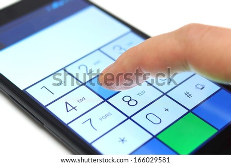 dialing on touchscreen smart phone - stock photo