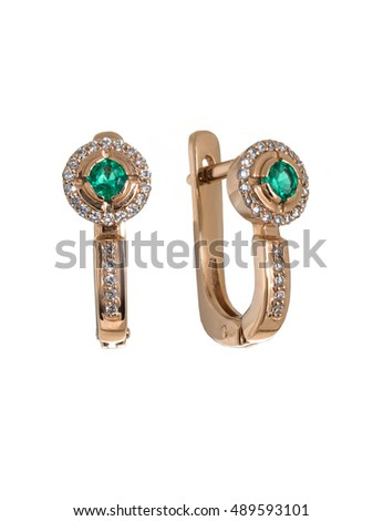 diamond and emerald earrings isolated on white
