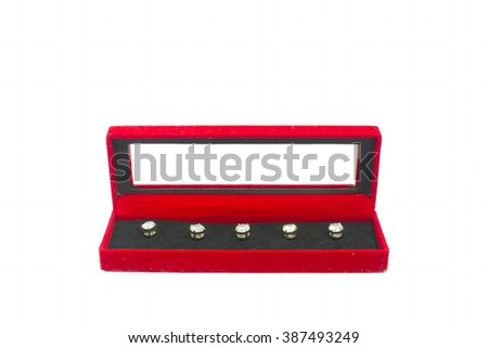 diamond buttons in a velvet red box - stock photo