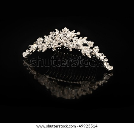 Diamond comb for hair on a black background with reflexion - stock photo