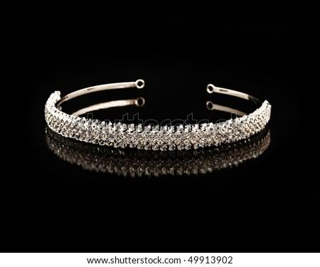Diamond diadem on a black background with reflexion - stock photo