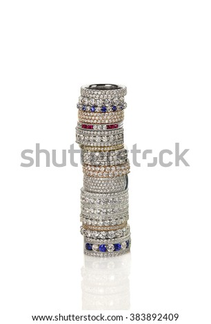 Diamond gemstone rings stacked together bridal wedding and engagement setting isolated on white - stock photo