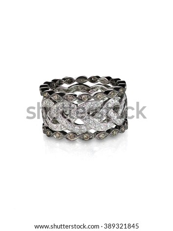 Diamond gemstone rings stacked together bridal wedding and engagement setting isolated on white