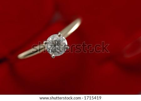 Diamond gold ring on red - macro - stock photo