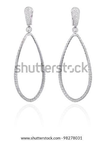 Diamond hoops earrings on white. - stock photo