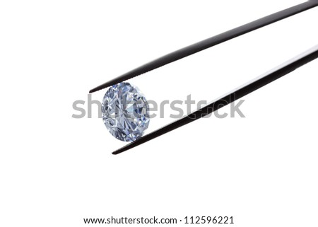 diamond in the tweezers on a white background