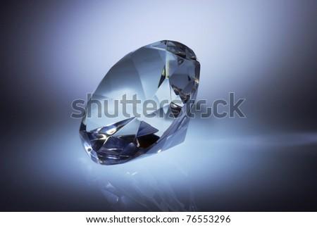 Diamond jewel on dark blue background - stock photo
