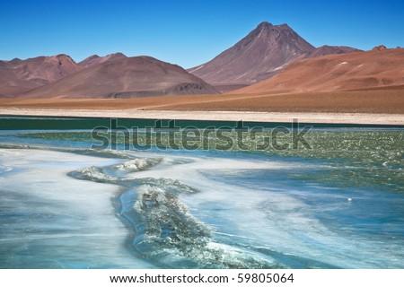 Diamond lagoon in Atacama desert, Chile, focus on the cracked ice - stock photo