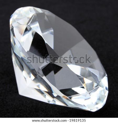 Diamond macro on black - stock photo