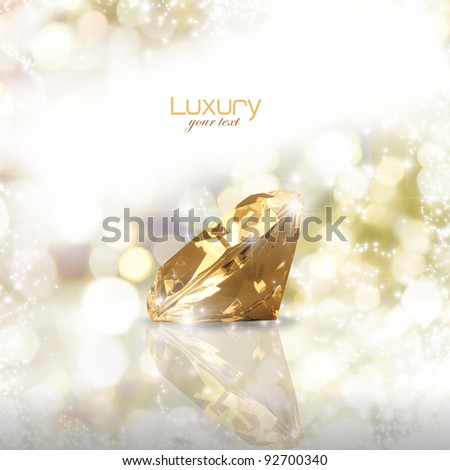 Diamond on a golden background with blank space for your text - stock photo