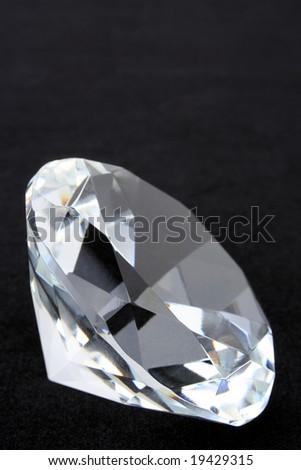 Diamond on black with top copy space - stock photo