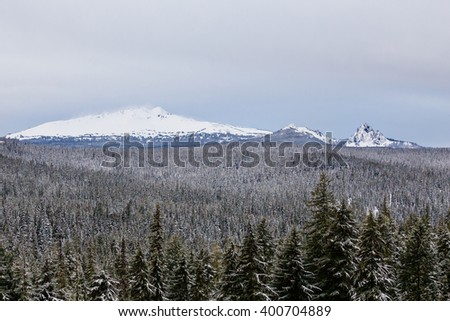 Diamond Peak rises above the trees in the Willamette National Forest of Oregon. - stock photo