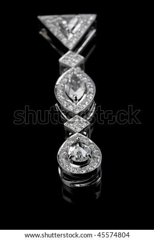 Diamond pendant on black ground - stock photo