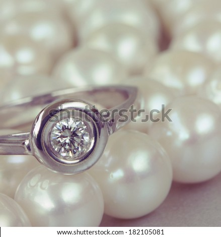 diamond ring on pearls  abstract background
