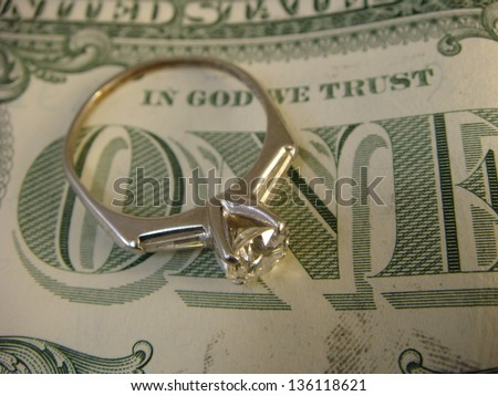 """Diamond Ring Over The Words """"IN GOD WE TRUST"""" Located On The Reverse Of The United States One Dollar Federal Reserve Note; Shallow Depth Of Field; Artistic & Dramatic Lighting; - stock photo"""