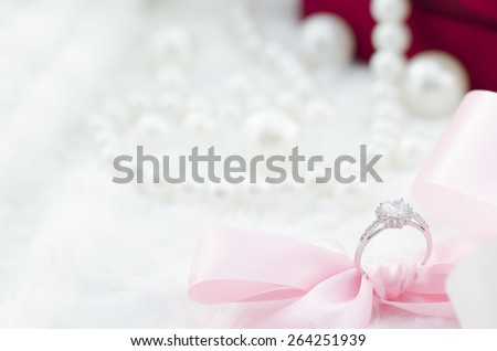 Diamond ring with pearl necklace - stock photo