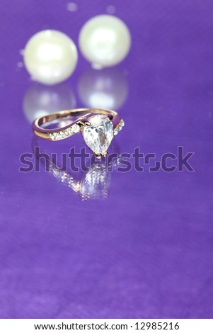 Diamond Ring with Pearls on Purple Background