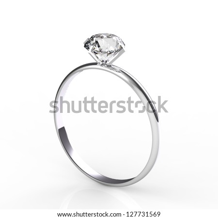 diamond solitaire ring on a white background - stock photo