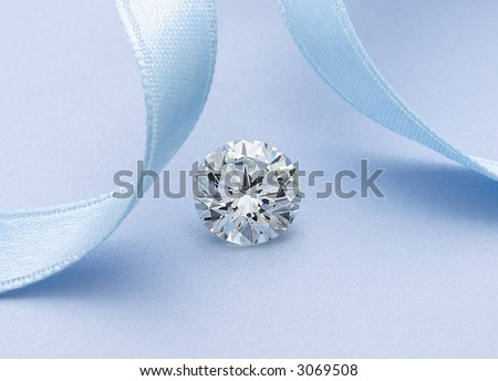 Diamond Solitaire with blue ribbon - stock photo