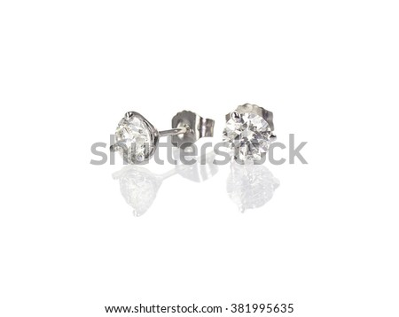 Diamond stud fine jewelry round brilliant pierced earrings isolated on white with a reflection - stock photo