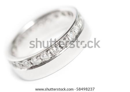 Diamond wedding ring on white background - stock photo