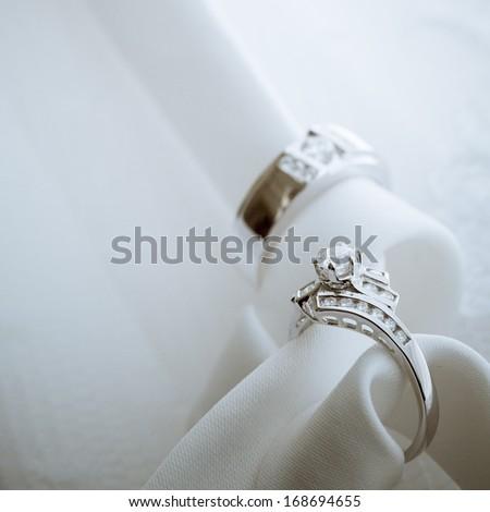 Diamond wedding rings on white background - stock photo