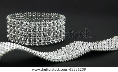 diamonds bracelet in black background - stock photo
