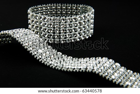 diamonds bracelet in black background - stock photo