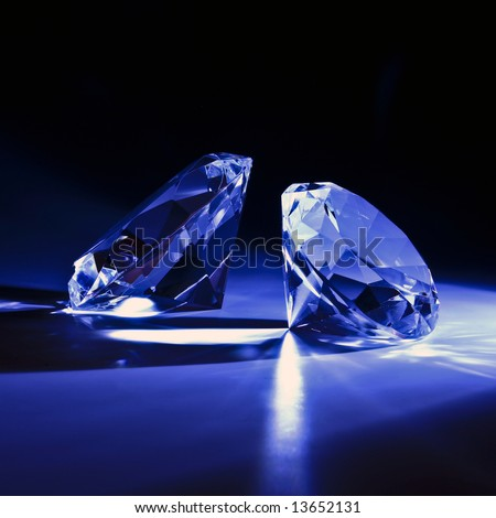 Diamonds close-up with blue ray 2 - stock photo
