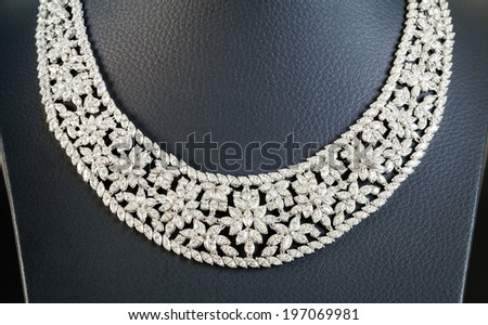 diamonds necklace on the black background - stock photo