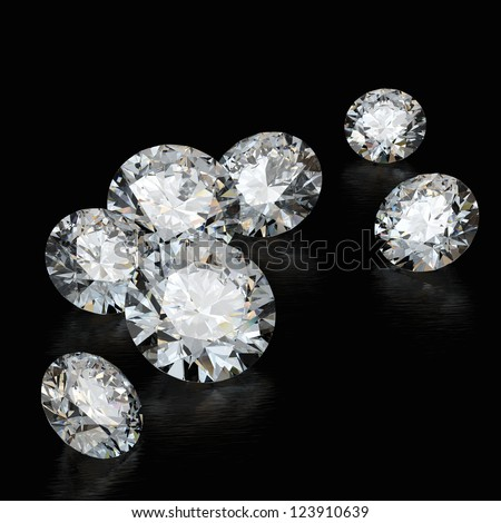 diamonds on a black background with the play of color in the faceting - stock photo