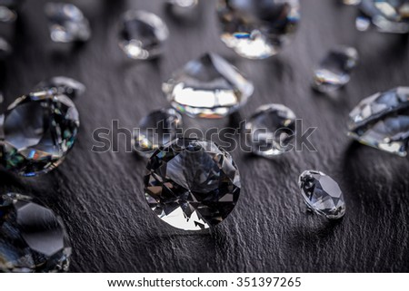 Diamonds on dark metal background - stock photo
