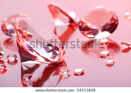 diamonds with different sizes in pink light - stock photo