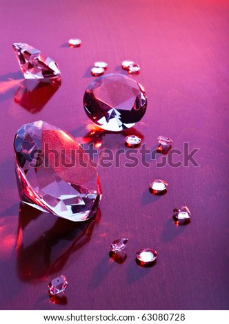diamonds with different sizes in red light - stock photo