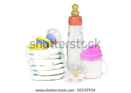 Diapers, Pacifier and toy - stock photo