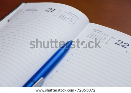 Diary and a pen. Business still life - stock photo