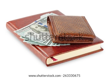 Diary and brown leather wallet with a wad of hundred dollar bills isolated on white background