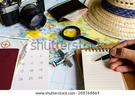 diary and calendar with passport and map, Travel planning - stock photo