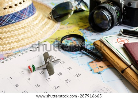 Diary and calendar with passport, Travel concept - stock photo