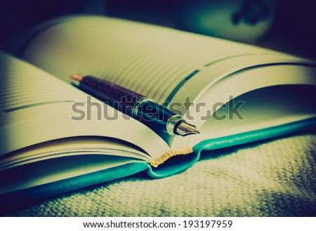 Diary and fountain pen. LOMO style. Selective focus.  - stock photo