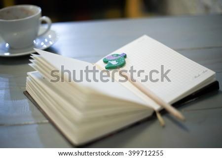 Diary and fountain pen. LOMO style. Selective focus. - stock photo