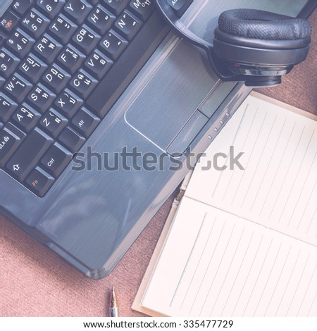 diary and laptop on desk - vintage color ton - stock photo