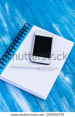 diary and mobile phone  on the table - stock photo