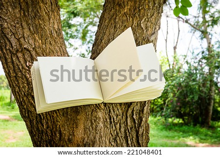 diary and notebook on tree for learning concept
