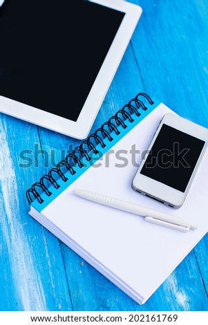 diary, mobile phone, tablet PC on the table - stock photo