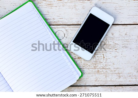 diary; mobile phone; tablet PC on the table - stock photo