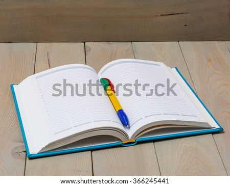 Diary on wooden deck table  - stock photo