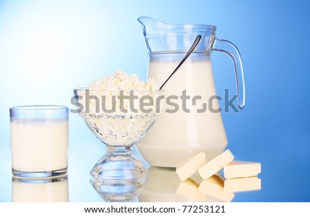 Diary products on blue background - stock photo